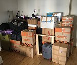 35 boxes, 1 tv, 2 bags, 2 bikes, 2 minibikes, 1 snowboard, 1 carpet, 1 TV Table.